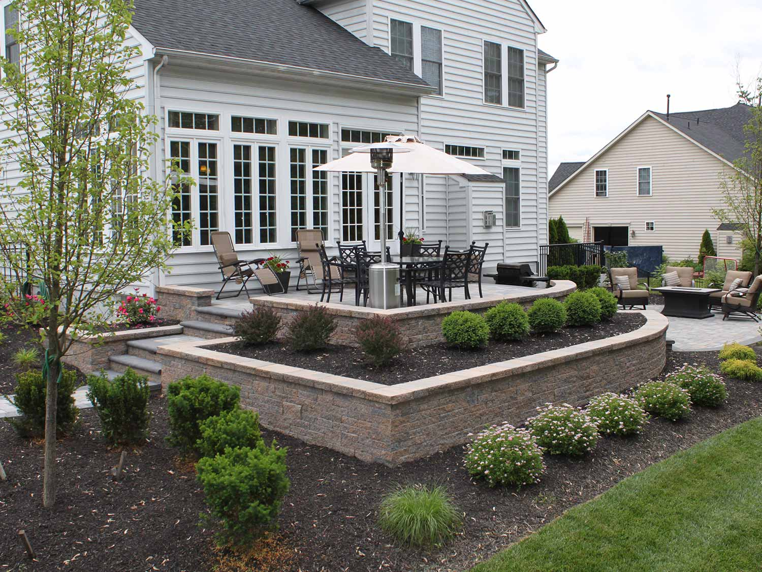 Raised Patio Design - R & R Caddick Design