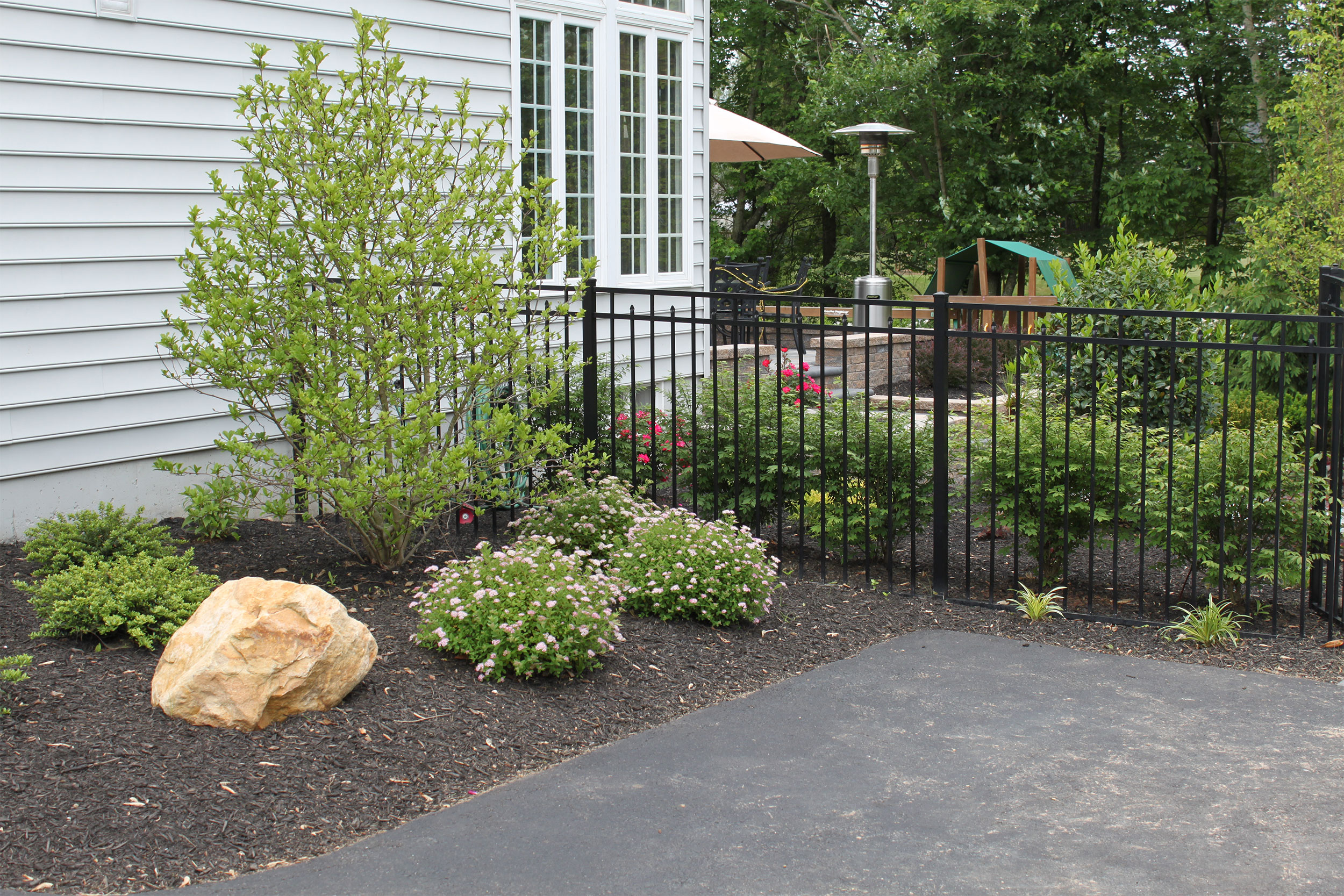 raised-patio-landscaping by R & R Landscape Design